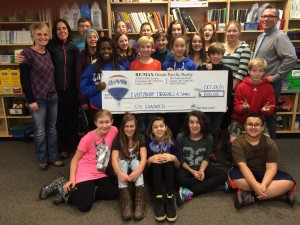 EDAS Club Puntledge Park Elementary accepts a $600 donation from Remax